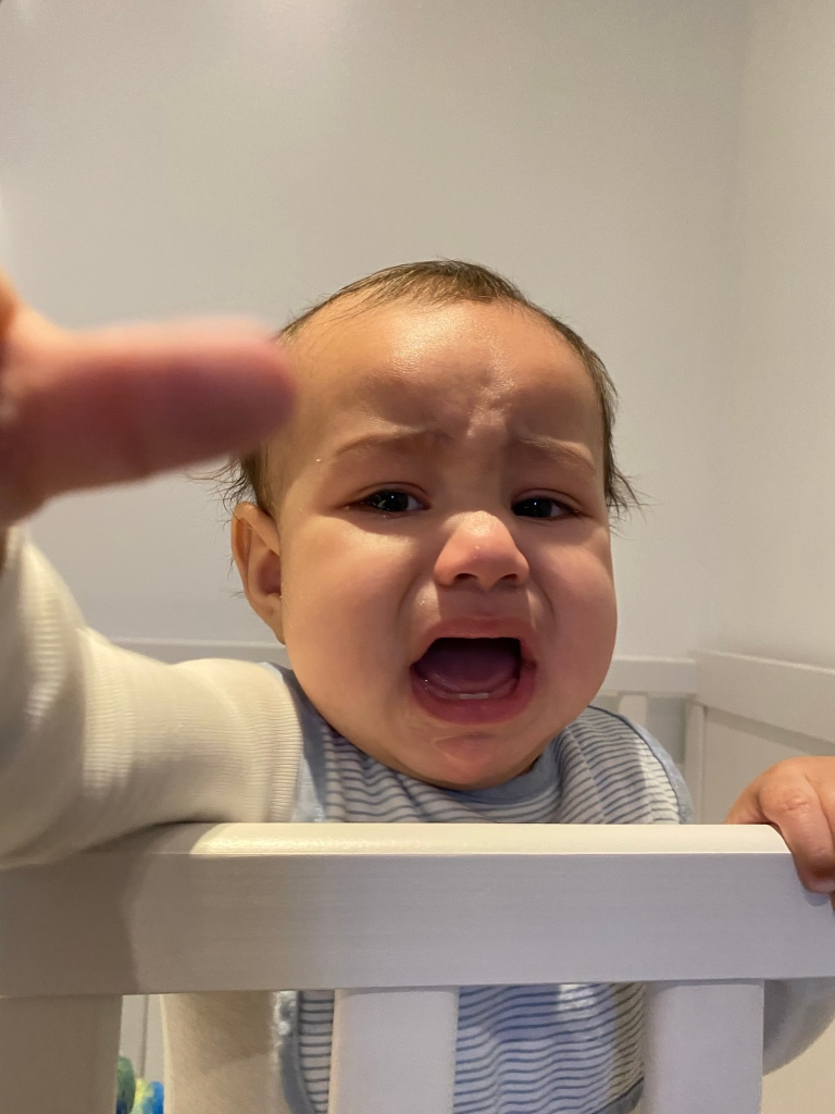 Crying baby in a crib
